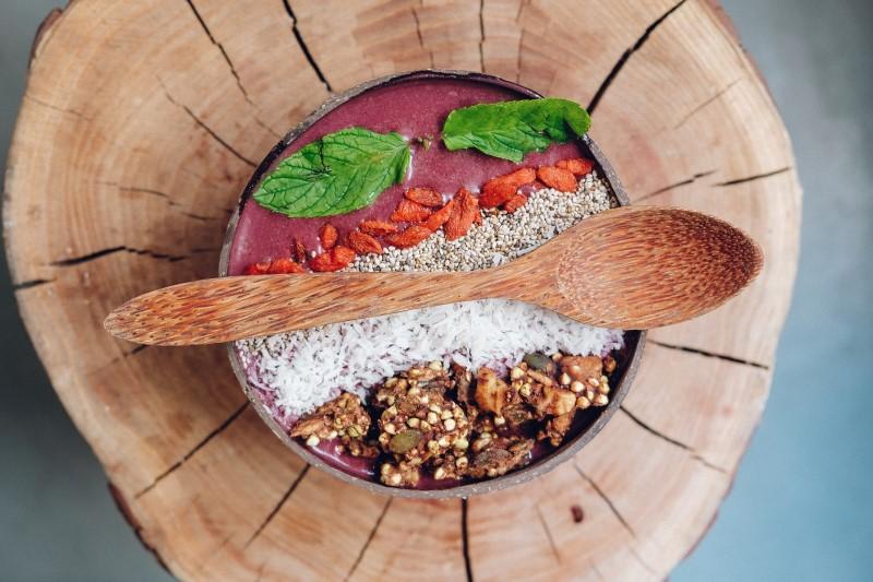 Bowl containing acai, goji berry, granola