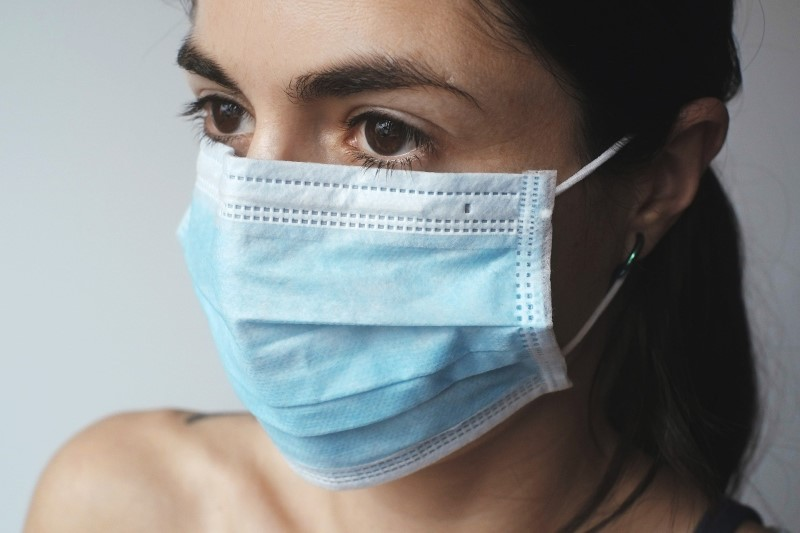 Woman wearing a disposable mask