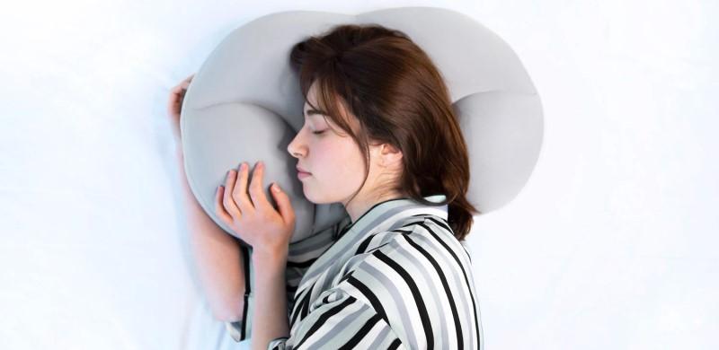 Girl sleeping on a Necklow pillow